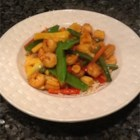 Easy Shrimp Stir-Fry - Bright, colorful vegetables team up with tender shrimp in a tangy sauce with just a hint of heat for a quick stir fry that will delight the eye and the taste buds. Serve over hot cooked rice.