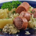 Alsatian Pork and Sauerkraut - Bacon, pork chops, and kielbasa sausage flavor this hearty one-skillet supper with sauerkraut and potatoes, made in the eastern French style.