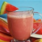 Watermelon Milkshake - A cold refreshing drink of watermelon, milk, and sugar is perfect on a hot summer day.