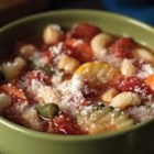 Marvelous Minestrone - Ready to serve in 25 minutes, this easy minestrone with garbanzo beans, macaroni, and veggies is topped with grated Parmesan cheese.