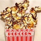 Caramel Chocolate Corn - Popcorn and peanuts are melded with brown sugar and butter, then drizzled with milk chocolate for a triple fix.