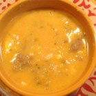 Butternut Squash and Spicy Sausage Soup - The perfect autumn soup, this hearty dish with a chicken broth base combines baked butternut squash, spicy turkey sausage, white rice, corn, and a dash of heavy cream, if desired.
