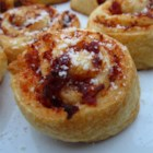 Sun-Dried Tomato Palmiers - Flaky/crispy dough filled with savory sun-dried tomato filling, and topped with grated Parmesan cheese.  Perfect appetizer for a fancy get together.  No one has to know how easy they are to make!