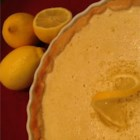 The Best Lemon Tart Ever - Rich lemon filling makes up the center of a decadent tart with a golden-brown shortbread crust.