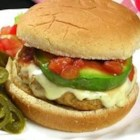 Ground Chicken Taco Burgers - Ground chicken blended with minced onion, garlic, and taco seasoning is a terrific alternative to regular hamburger patties. Topped with pepper jack cheese slices, avocado, jalapenos, and salsa on wheat buns, every bite sizzles with South-of-the-Border flavor.