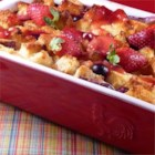 Strawberry Cream Cheese French Toast - Bread cubes, strawberries, and cream cheese are baked into a sweet, French toast casserole topped with homemade strawberry sauce for an easy make-ahead weekend brunch.