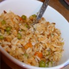 Maria's Mexican Rice - A serrano pepper kept whole adds flavor without bringing heat to this Mexican-style rice dish with tomato and onion.