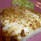 Grilled Halibut - Making a quick compound butter to spread on your halibut steaks is a perfect way to get a tasty grilled fish.