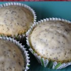 Quick Lemon Poppy Seed Muffins - This recipe delivers lemony lemon poppy seed muffins with a sweet glaze.