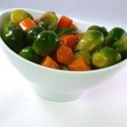 Glazed Carrots and Brussels Sprouts - Carrots and Brussels sprouts are glazed with a beef consomme sauce creating a colorful addition to the Thanksgiving table.