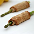 Asparagus Roll-Ups - Multi-grain bread rolled around asparagus, cream cheese, and bacon make for tasty appetizers you can eat without utensils.