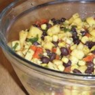 Mango Black Bean Salad - This refreshing and colorful bean salad is loaded with mango, black beans, corn, and red pepper.