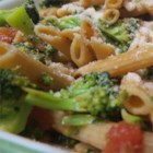 Fusilli with Rapini (Broccoli Rabe), Garlic, and Tomato Wine Sauce - Broccoli rabe, also known as rapini, is an Italian vegetable related to broccoli, with a savory, intense flavor. It plays well with garlic, tomatoes, and fusilli pasta for a quick dinner that's on the elegant side.