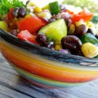 Black Bean and Cucumber Salad - Black beans add protein to this cucumber salad seasoned with orange marmalade, honey, cumin, and lemon juice.