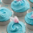 Cotton Candy Cupcakes - Homemade cupcakes topped with cotton candy frosting bring the fun of a county fair right into your kitchen.