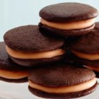 Orange Creme Whoopie Pies - Orange Crème frosting sandwiched between two rich chocolate cakes will surely make them shout, 'Whoopie'!