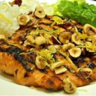 Grilled Salmon with Lemon Hazelnut Sauce - The perfect make-ahead BBQ party dish with the richness of hazelnuts and zing of lemon.  Simple, elegant, fast and delicious, it's a hit at every gathering!
