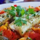 Mainely Fish - Haddock fillets, sliced tomatoes, and red and yellow peppers baked in individual foil packets. Great served with rice and steamed asparagus.