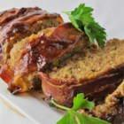 BBQ Bacon-Wrapped Meatloaf - Barbeque sauce-infused meatloaf is wrapped with bacon strips for a flavorful and rich twist on the traditional meatloaf.