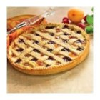 Linzer Torte - This is a beautiful and tasty tart-like dessert, made by layering fruit preserves on a crumbly almond and lemon butter crust.