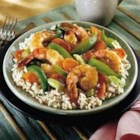 Shrimp Stir-Fry - Tender shrimp and crisp vegetables are stir-fried with a garlic and ginger flavored sauce made from Swanson(R) Chicken Stock, soy sauce and sesame oil, for a savory seafood and vegetable stir-fry.