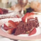 Passover Chocolate Torte - Finish a special holiday meal with an elegant torte made from kosher margarine, eggs, sugar, ground almonds and morsels of chocolate. Dust with powdered sugar and top each slice with a fresh strawberry.