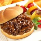 Pulled Barbecue Beef Sandwiches - Delicious hot beef sandwiches in a tangy barbecue sauce made in a snap using leftover beef from Many Meals Pot Roast.