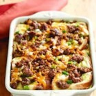 Sausage and Apple Breakfast Casserole - Sweet, spicy apple chunks, sausage, and Cheddar cheese add loads of flavor to this egg and bread cube casserole that's perfect for brunch.