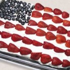 Red, White and Blue Strawberry Shortcake - A 9x13 inch cake is frosted with whipped topping and decorated with blueberries and strawberries to resemble an American flag.