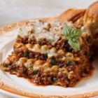 Hearty Meat Lasagna - This classic layered pasta, sauce and cheese dish gets a zesty boost with the addition of chunky, chili sauce.