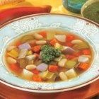 Swanson(R) Winter Vegetable Bean Soup with Pesto - This classic soup combines carrots, potatoes, turnips, leeks and celery in savory Swanson(R) Chicken Broth with hearty white beans and a flavorful basil pesto garnish.