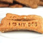 Doggie Biscuits I - These are our dog's favorite treats!  If your dog has a corn allergy, you can substitute additional flour or oats for the cornmeal.  Bone appetit!