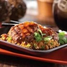 Szechwan Beef Burgers with Sweet and Hot Sauce - Zesty burgers are served atop fried rice, and garnished with an apricot and plum sweet and sour sauce.