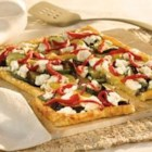 Grilled Pesto Vegetable Tart - Pepperidge Farm(R) Puff Pastry Sheets make a tender crust for this savory tart filled with layers of pesto, roasted Mediterranean vegetables, crumbled goat cheese and strips of roasted red peppers.