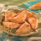 Mushroom and Bacon Triangles - These hors d'oeuvres are truly easy to make! Roll out thawed Pepperidge Farm(R) Puff Pastry Sheets and cut into squares. Fill with mushroom-cheese filling and fold into mini triangles before baking.