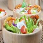 Grilled Shrimp Salad with Sesame Ginger Vinaigrette - Hot grilled shrimp and cherry tomatoes top this sesame-flavored salad.