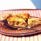 Sausage Cornbread Bake - A slice of this tangy cornbread reveals a hidden layer of sausage, onion and Cheddar.  It makes a nifty meal on-the-go or a snack for family and friends.