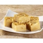 EAGLE BRAND(R) Peanut Butter Fudge - The family will go wild for this peanutty fudge. Peanut butter, chopped peanuts, and white chocolate really make it special.