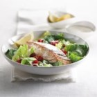 Warm Salmon and Grape Tomato Salad - Warm salads topped with seared salmon are ever-popular on restaurant menus. Now, with a touch of garlic-enhanced Cream, you can make a sensational salad at home in just minutes.