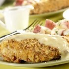 Chicken Crunch - Oven-fried chicken is crunchy with a coating of herb-seasoned stuffing.