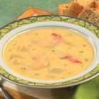 Seafood Chowder - Shrimp and white fish simmer quickly in a creamy potato broth spiked with sauteed onion, garlic and dill.