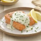 Grilled Salmon with Creamy Pesto Sauce - This velvety and versatile sauce is also delicious served with chicken or other varieties of fish. For even more flavor, additional pesto could be brushed over the salmon before grilling.
