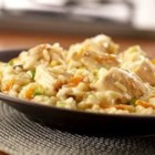 Creamy Chicken Risotto - Chock full of chicken, carrots and green onion, this creamy rice dish is made special with a mixture of Campbell's(R) Condensed Cream of Mushroom with Roasted Garlic Soup, Campbell's(R) Condensed Chicken Broth and Parmesan cheese.