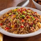 Dulac Dirty Rice - This dish has it all. It gets color from the bell peppers, crunch from the pecans, sweetness from the raisins and saltiness from the bacon.