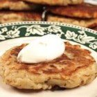 Potato Pancakes - Potatoes and onion grated, combined with eggs and pancake mix, and cooked just like breakfast pancakes.  Excellent when served with warm sour cream.