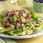 Lemon Blueberry Chicken Salad - Crunchy celery and sweet blueberry dressing flavors this chicken salad set atop mixed salad greens.