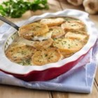 Creamy Garlic Potatoes from the LACTAID(R) Brand - In this comforting and hearty casserole potato slices are pan fried before they are baked in a creamy garlic sauce.