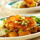 Polynesian Pork Chops - Sweet 'n sour pork chops shine in this easy recipe featuring pineapple, onion, soy sauce, green onions and Campbell's(R) Condensed Golden Mushroom Soup.