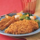 Crunchy No-Fry Chicken - Chicken is dipped in Swanson(R) Chicken Stock, coated with seasoned cereal crumbs and baked until crispy and golden.