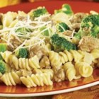 Sausage and Broccoli Skillet - Hot cooked pasta is topped with a hearty and flavorful sauce made with Campbell's(R) Condensed Cream of Broccoli Soup, sausage, onion, garlic, broccoli cuts and Parmesan cheese.